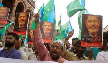 Supporters of the Pakistani religious party Jamaat-i-Islami, chant slogans for ousted former Egyptian President Mohammed Morsi in Hyderabad, Pakistan, June 18, 2019