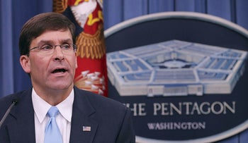 In this file photo taken on July 13, 2018, US Army Secretary Mark Esper announces that Austin, Texas, will be the new headquarters for the Army Futures Command during a news conference at the Pentagon in Washington, DC