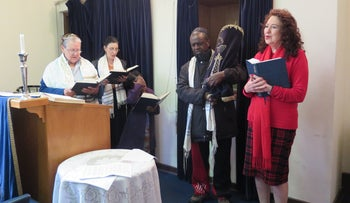 Worshippers, including Reeva Forman, right, at Temple Israel synagogue in Hillbrow, Johannesburg, during a Shabbat service in May 2019.