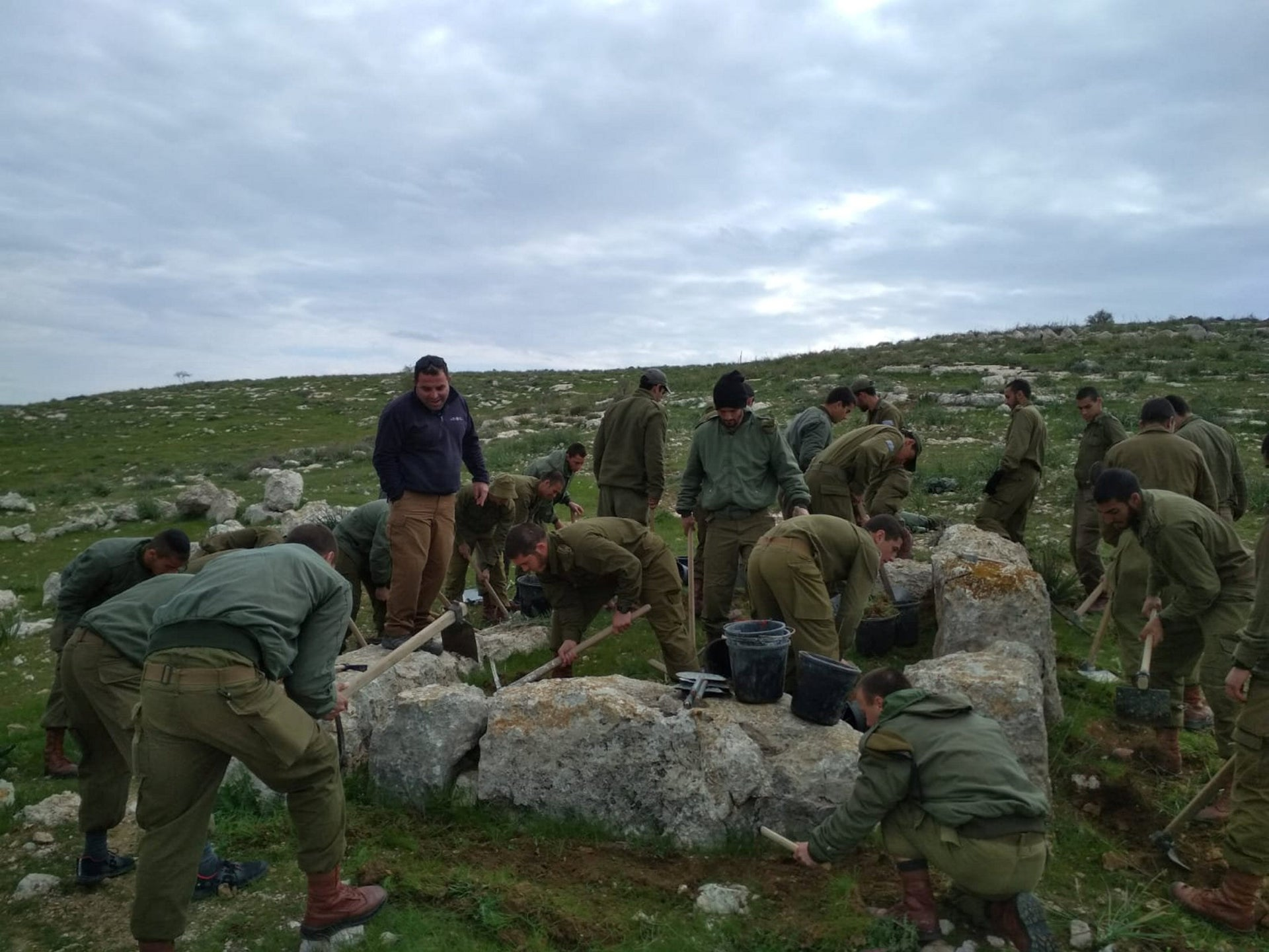 Paratroopers working with archaeologists, excavating a 2,800-year-old watchtower