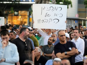 Residents demonstrate against the operation of public transportation on Shabbat, Ramat Gan, Israel, June 12, 2019.