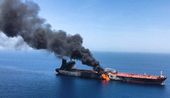 An oil tanker seen on fire in the sea of Oman, June 13, 2019. A series of attacks have ratcheted up tensions between the U.S. and Iran