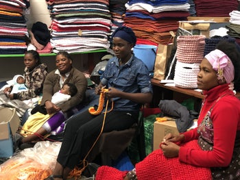 A group of women, all from the nearby Joe Slovo Park township, working at Hangar 18 in the Milnerton suburb in northern Cape Town.