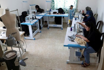 Syrian refugees work sewing at a workshop in the town of Bar Elias, Bekaa Valley, Lebanon, June 17, 2019.