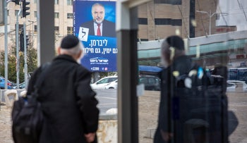 """A Yisrael Beiteinu campaign poster featuring Avigdor Lieberman with the slogan: """"Both right-wing and secular."""""""