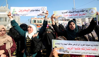Palestinian female supporters of the Islamic Jihad protest against the Bahrain economic workshop in the southern Gaza Strip town of Rafah, June 18, 2019.