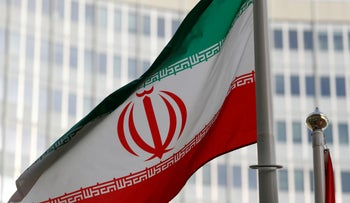 The Iranian flag flutters in front the International Atomic Energy Agency (IAEA) headquarters in Vienna, Austria March 4, 2019.