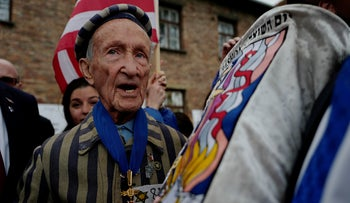 Holocaust survivor Edward Mosberg holds a Torah as he arrives to take part in the annual 'March of the Living' to commemorate the Holocaust at the former Nazi death camp Auschwitz, in Oswiecim, Poland, May 2, 2019.