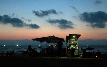 People sitting on the seafront at Gaza City, June 12, 2019.
