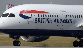 A British Airways aircraft taxies on a runway with the Pakistani and Union Jack flags upon landing at the Islamabad International Airport on the outskirts of Islamabad on June 3, 2019.