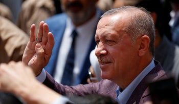 Erdogan greets people after casting his ballot, outside a polling station in Istanbul, June 23, 2019.