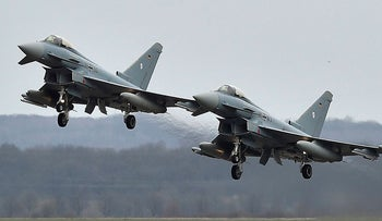 In this March 21, 2016 file photo, two Eurofighter jets perform at the German Air Force Base in Noervenich, western Germany. Two German Eurofighter military planes crashed today near the city of Jabel in eastern Germany