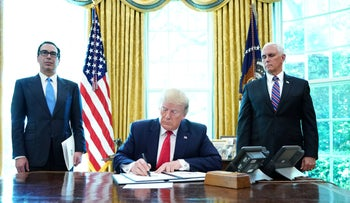 Trump signs new sanctions Iran's supreme leader at the White House, June 24, 2019.