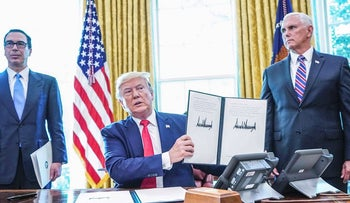 US President Donald Trump signs with US Vice President Mike Pence(R) and US Secretary of Treasury Steven Mnuchin at the White House on June 24, 2019, 'hard-hitting sanctions' on Iran's supreme leader