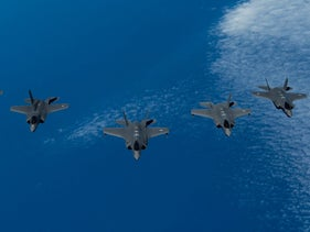 Six F-35 fighter jets - two each from Israel, the U.S., and the U.K. - fly in an exercise on June 25, 2019.
