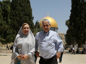 Chilean President Sebastian Pinera and his wife Cecilia Morel stand in front of the Dome of the Rock in Jerusalem, June 25, 2019.