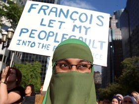 People protest Quebec's new Bill 21, which will ban teachers, police, government lawyers and others in positions of authority from wearing religious symbols, in Montreal, Quebec, Canada, June 17, 2019.