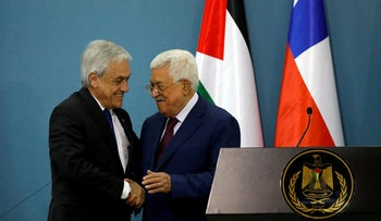 Sebastian Pinera with Mahmoud Abbas during a joint news conference in Ramallah on June 27, 2019.