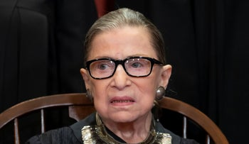 Justice Ruth Bader Ginsburg sits with fellow Supreme Court justices for a group portrait at the Supreme Court Building in Washington, November 30, 2018.
