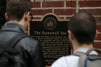 People look at the historical landmark sign outside The Stonewall Inn in New York, U.S., May 30, 2019. Picture taken May 30, 2019. REUTERS/Brendan McDermid