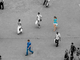 Illustration: People walk on the street, some look at their phones.