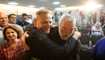 Nitzan Horowitz and Meretz lawmaker Ilan Gilon embracing after it was announced the journalist was elected to chair the party, Tel Aviv, June 27, 2019.