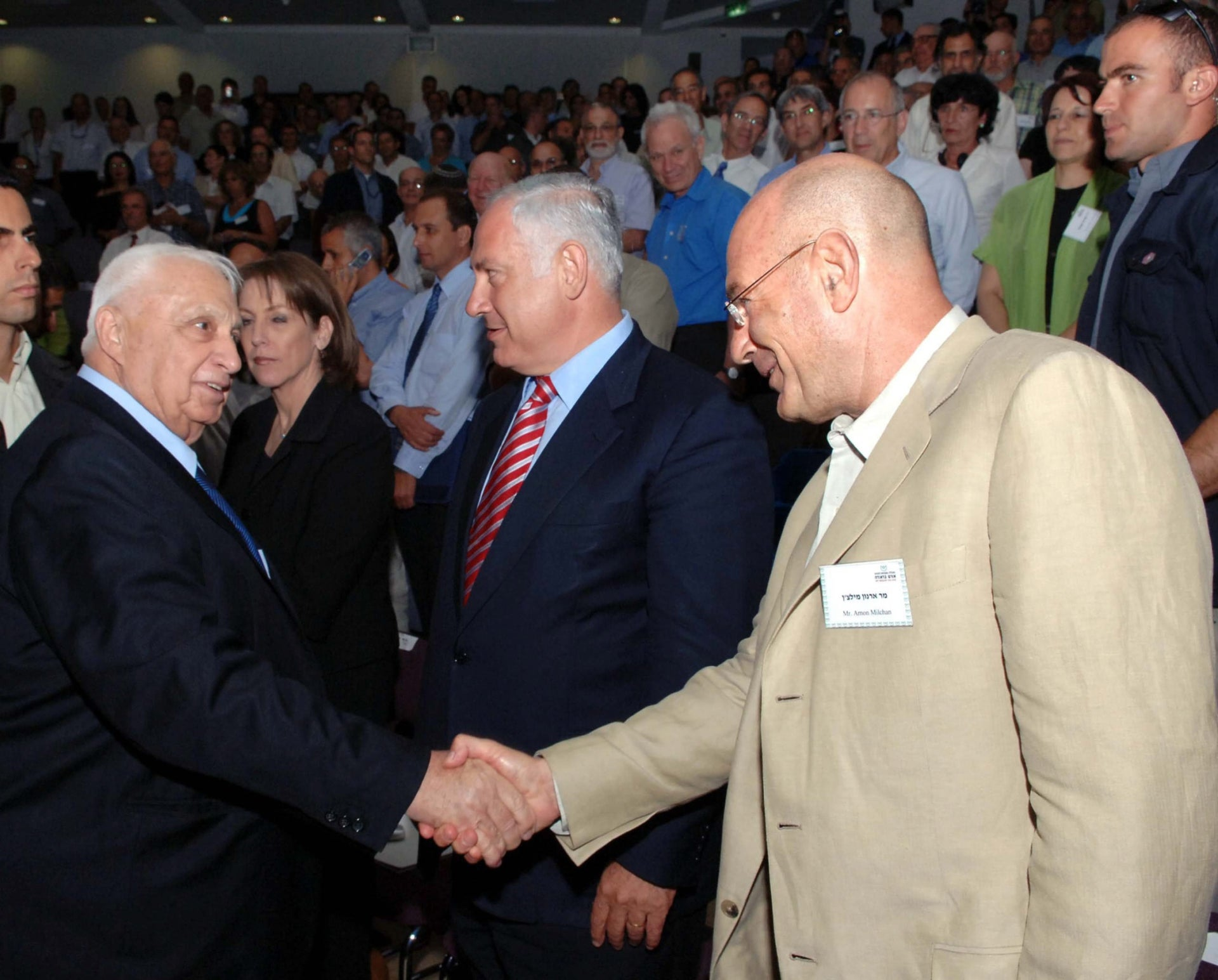 Arnon Milchan, right, shaking hands with Prime Minister Ariel Sharon in 2005.
