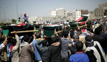A funeral procession following an airstrike that killed 12 civilians, including seven children in Sanaa, Yemen, April 10, 2019.
