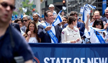 New York Gov. Andrew Cuomo, center, takes part in the Celebrate Israel Parade in New York, June 2, 2019.