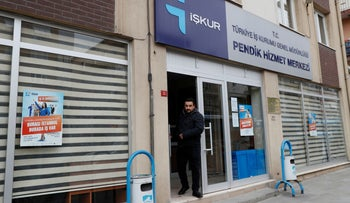 An unemployed man leaves an office of the Turkish Employment Agency in Istabul on April 19, 2019.