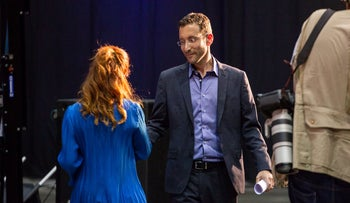Labor leadership candidate Stav Shaffir (left) crosses paths with rival Itzik Shmuli (right) at the Labor party convention, in Tel Aviv, June 2019.