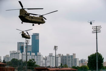 Support helicopters follow Marine One carrying Trump to the DMZ as they take off from Seoul, June 30, 2019.