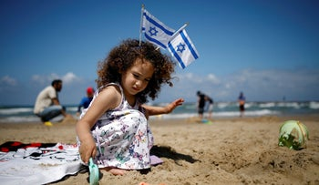 A girl plays on the beach as Israel celebrates its Independence Day marking the 71st anniversary of the creation of the state, in Tel Aviv, Israel May 9, 2019