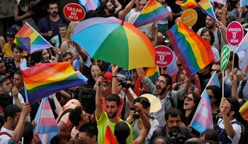 People celebrate on the street in central Istanbul, during a Pride march event in Istanbul, June 30, 2019.