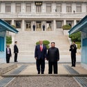U.S. President Donald Trump and North Korean leader Kim Jong Un stand at the demarcation line in the demilitarized zone separating the two Koreas, in Panmunjom, South Korea, June 30, 2019.