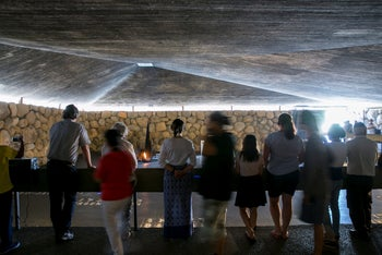 Tourists visiting the remembrance hall at the Yad Vashem Holocaust memorial center in Jerusalem (illustrative).
