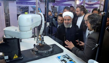 "Rohani listens to explanations on new nuclear achievements at a ceremony to mark ""National Nuclear Day,"" Tehran, Iran, April 9, 2018"