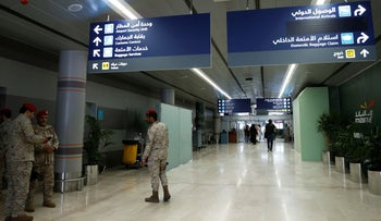 Saudi security officers are seen at Saudi Arabia's Abha airport, after it was attacked by Yemen's Houthi group in Abha, Saudi Arabia, June 13, 2019.
