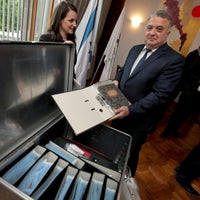 Israel's ambassador in Germany, Jeremy Issacharoff, right, holds documents prior to a handing over ceremony at the embassy of Israel in Berlin, Germany, May 21, 2019