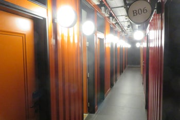 The units at the Spot hostel are enclosed in large metal containers erected in a large hall.