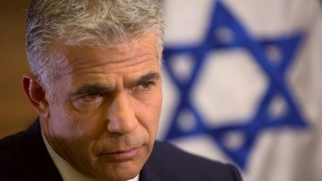 Former Finance Minister of Israel Yair Lapid looks on during an interview with The Associated Press, in his office at the Knesset, October 31, 2016