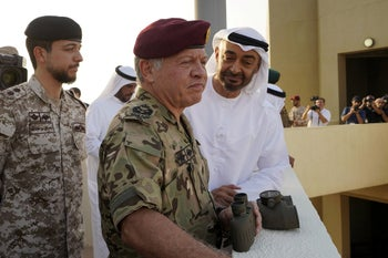 King Abdullah II (C) and Sheikh Mohamed ben Zayed Al-Nahyan (R), the Crown Prince of Abu Dhabi, observe joint Jordan-UAE military exercises in June 2019.