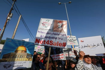 Protesters against the Bahrain conference with signs showing the Dome of the Rock and reading in Arabic 'Jerusalem is not for sale' near the US embassy in the Jordanian capital Amman. June 21, 2019