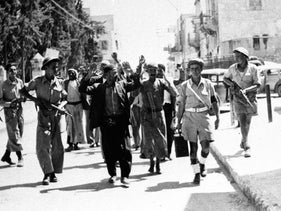 IDF soldiers guarding Palestinians in Ramle, in 1948.