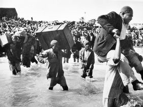 Palestine refugees initially displaced to Gaza board boats to Lebanon or Egypt, in 1949.