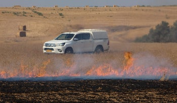Fires caused by incendiary balloons launched from Gaza blaze in a border community, June 28, 2019.