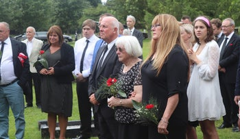 Friends and family of Derek Tom Bowden attending his burial in Diss, England, July 1, 2019.