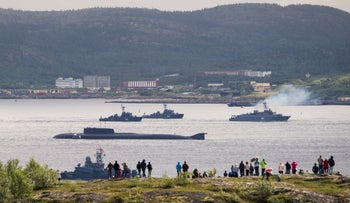 FILE Photo: Russian navy ships and a submarine take part in a naval parade at the port of Severomorsk, Russia, July 31, 2016.