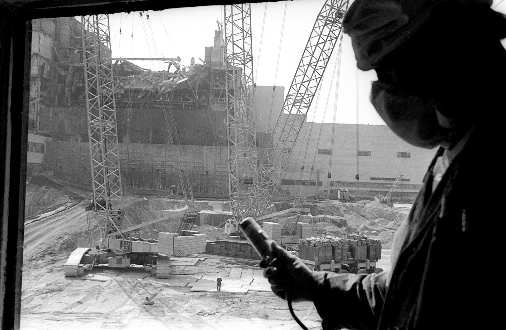 In this 1986 photo, a Chernobyl nuclear power plant worker holdד a dosimeter to measure radiation level.
