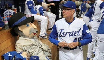 Israel's third base coach Pat Doyle passes by his team mascot at the the World Baseball Classic at Gocheok Sky Dome in Seoul, South Korea, on Thursday, March 9, 2017.